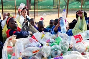 Teacher and learners count the number of PET collected in their community in the hopes of qualifying for prizes at the ABI Schools Recycling Awards.