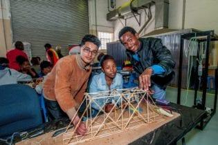 Jammy Francis (Alexander Road High School), Sinovuyo Mafu (Newton Tech High School) and Lubablo France (Gelvandale High School) testing the members of their warren truss bridge. Picture: SANRAL