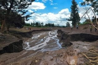 The water carved a fissure through the land - AFP