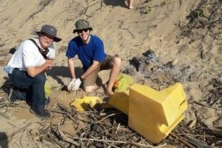 Anton Hanekom, Executive Director of Plastics SA (left) gets his hands dirty