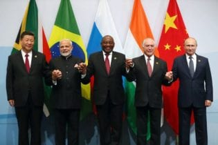 China's President Xi Jinping, Indian Prime Minister Narendra Modi, President Cyril Ramaphosa, Brazil's President Michel Temer and Russia's President Vladimir Putin pose for a group picture at the BRICS summit meeting in Sandton on July 26, 2018. Image: REUTERS/Mike Hutchings
