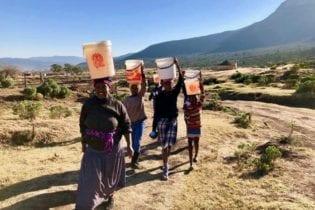 Fezeka Dzedze and her children still fetch water from a river despite R78-million being spent on a water project. Photo Wara Fana