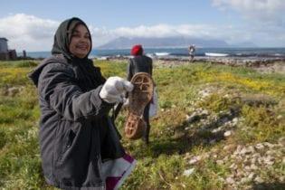 Volunteer Nadeema Peterson helping to clean up Robben Island
