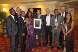 Bongani Mthombeni-Möller (Strategic Business Development Executive) and Arijit Mookerjee (Finance Director Africa) seen holding the certificate, CEO Kostas Rontiris and Kresen Manicum (Regional Manager, KZN), seen holding the trophy.